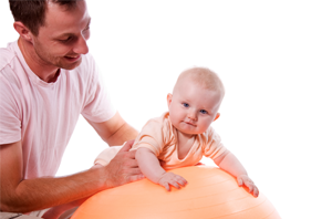 Pediatric occupational therapist with an infant patient